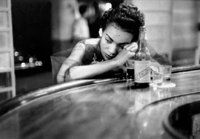 Eve Arnold Bar girl in a brothel in the red light district, Havana, 1954